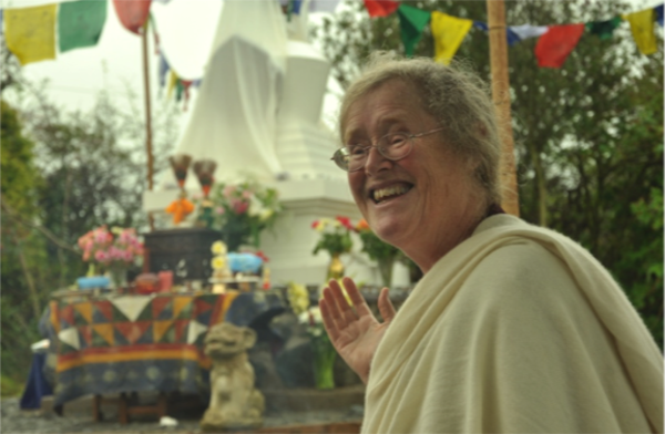Lama Shenpen indicates the Buddhist stupa at the Hermitage in Wales